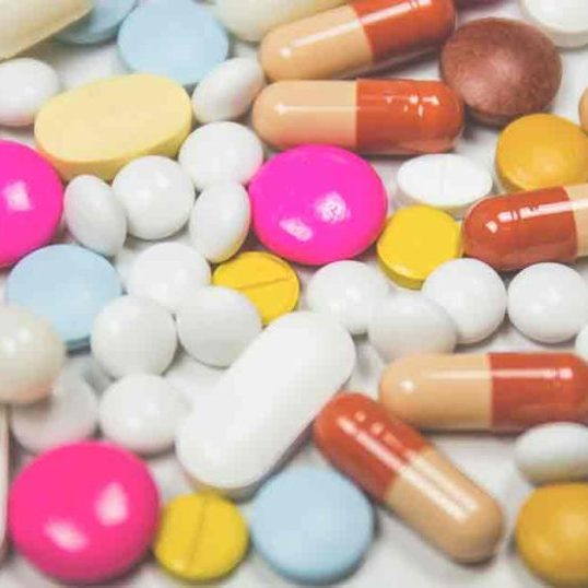 A multicolored pile of pills and capsules.