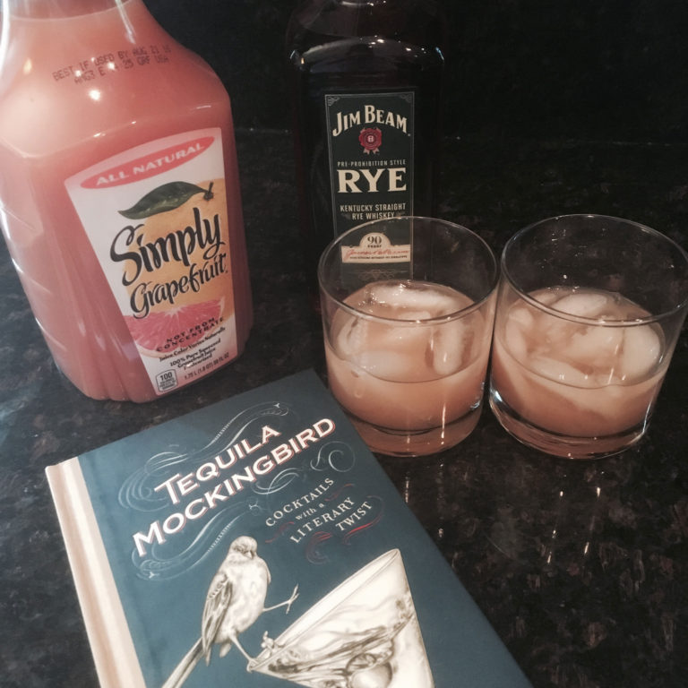 A half gallon of grapefruit juice, a fifth of Jim Beam rye whiskey, a copy of the book Tequila Mockingbird and two rocks glasses.